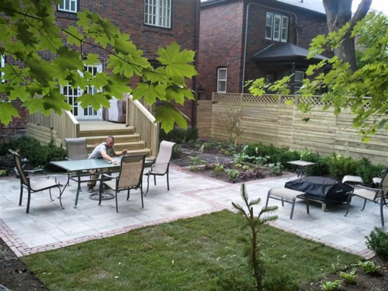 re design of back yard deck interlocking patio and planting